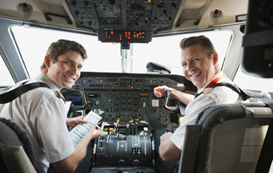 Airline pilots in cockpit. Recruited through CAE Parc Aviation